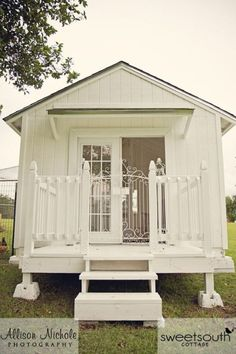 This adorable cottage is actually a chicken coop in disguise—wander across the porch, and you'll find a shabby chic chair and chandelier inside.  Learn more at Sweet South Cottage.