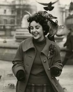 Photographed in a spontaneous moment, Elizabeth Taylor seems genuinely happy. Description from seraphicpress.com. I searched for this on bing.com/images