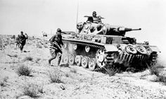 Front of North Africa  (DAK) Tank Panzer III F and German infantrymen chasing the enemy beyond Derna February 1942