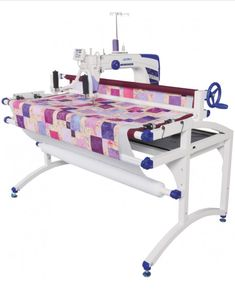 JUKI Miyabi S Sit Down Free Motion Quilting Machine and Table. The only sit-down longarm quilter with automatic thread trimmers and built-in JUKI SmartStitch stitch regulator system. Quilting Frames, Quilting Rulers, Longarm Quilting, Free Motion Quilting, Machine Quilting, Direct Lighting, Fingerless Gloves Knitted, Juki, 10 Frame
