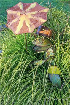 Gold Carex grass is a perfect companion for this garden art.