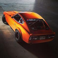 beautiful orange Datsun 240Z race car