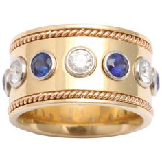 1950s Sapphire Diamond Gold Wide Eternity Band | From a unique collection of vintage band rings at http://www.1stdibs.com/jewelry/rings/band-rings/