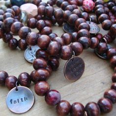 The more the merrier in these everyday wearable arm candy braceets, Each is handstrung by Barbara with beautiful meaningful beads and a hand stamped charm. Perfect for stocking stuffers, hostess gifts, or just because!   Dark wood bracelets are made from rosewood beads from vintage malas. Light...