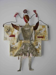 book art doll made her debut in Opie and Linda O'Brien's book Dada Dolls