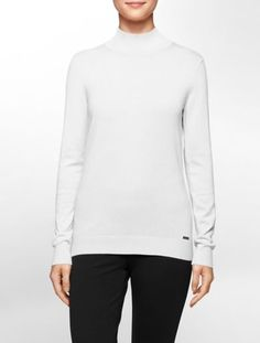 an iconic sweater with a mock neck and rib knit trim make this a versatile style.