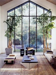 Un mur de verre pour une maison dedans/dehors