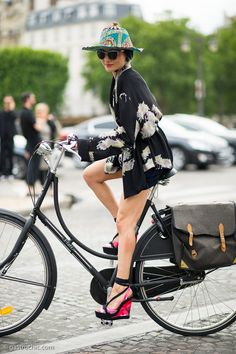 Catherine Baba at Dior, July 3, 2013 | Stylist Catherine Baba made an entrance at the Dior couture show, biking up in platform heels and a silk Chinese robe.