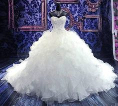 Ball Gown Wedding Dress Embroidery Vintage Sweetheart Organza Ruffles Wedding Gowns Item Type: Wedding Dresses Waistline: Natural Dresses Length: Floor-Length Silhouette: Ball Gown Neckline: Sweethear