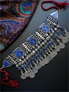 This stunning vintage Tribal Kuchi jangly choker necklace is in excellent condition with all beads, pieces, and coins intact. It was skillfully and sturdily handcrafted in the late 1900's by Afghan Kuchi Tribal Jewelry artisans using local Lapis Lazuli and jangle coins.