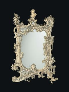 * A GERMAN PARCEL-GILT CARVED IVORY MIRROR |  BY U. DIEßL, MUNICH, DATED 1891