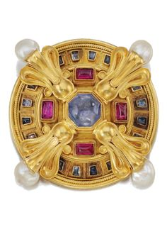 Gold and Gem-set brooch, Castellani, circa 1860. The circular plaque with rope work decoration, set with cultured pearls, cabochon sapphires and rubies, maker's mark for Castellani, later pendant loop.