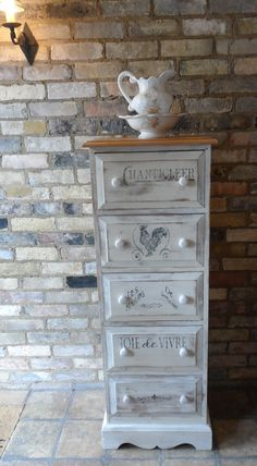 Tall solid heavy pine jumper chest finished with one coat of Annie Sloan Original, heavily rubbed back. French Chanticleer motifs painted to drawers, and finished with wax. £139