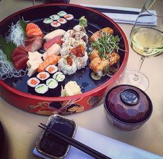 Sushi and Wine!  #sushi #sushitime #lunch ##photooftheday #lunchtime #nofilter #nofilterneeded #sushilovers #sushilover #fish #friday #weekend #nofilter #enjoy #love #waitingforsummer #instagood #pornfood #food #foodporn #follow #restaurant #pranzo #with #friends #rimini #sea #beach by sandra_igiede