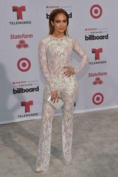 Jennifer Lopez Jumpsuit - For her Billboard Latin Music Awards look, Jennifer Lopez chose a sheer white lace jumpsuit by Zuhair Murad.