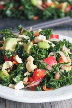 Kale Salad with Edamame, Roasted Cashews and Miso Dressing - Domesticate ME! - Best salad ever, used baby kale, dried cherries and macadamias, soooo good.