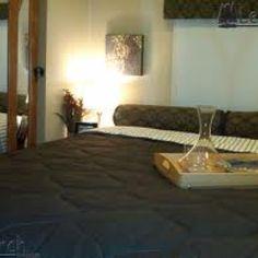 This a bed in an RV but looks like a bed in a home
