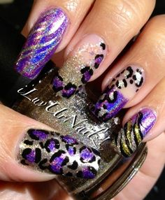 The colors I used to achieve this look are Jades Fascino Violeta, China Glazes I'm Not Lion & Snow Globe I also used Wet n Wilds Fergies Going Platinum I did some leopard prints with black acrylic paint   iluvurnailz.tumbl...
