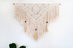 A personal favourite from my Etsy shop https://www.etsy.com/au/listing/479600417/macrame-wall-hanging-inferno