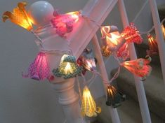 string of lights with origami flowers