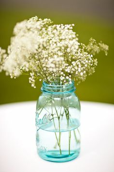 Baby's breath in a mason jar!  So simple and lovely...