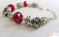 A sensual deep red and silver medieval like snake chain bracelet.