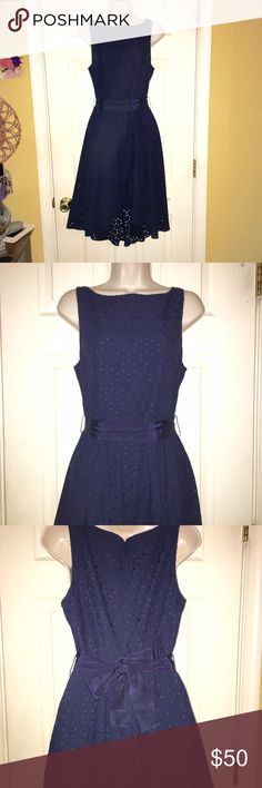 BB Dakota navy eyelet dress 4 NWOT!! Never worn! Insane beautiful dress. Navy blue eyelet dress with tie around waist. Slight high low with a high crew neckline. Zips up the back. The entire dress is 100% cotton (shell and liner)  Pictures really don't do this dress justice. Can model if need be. Offers welcome, bundle to save!! BB Dakota Dresses Midi