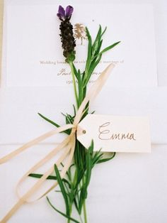 In keeping with the garden theme, small luggage tags tied with lavender and thyme made fragrant place names. Stationery for the celebration, including these menu cards, were supplied by Hello!Lucky (hellolucky.co.uk).