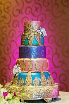 Moroccan inspired wedding cake. Will you go with color on your cake? #disneyweddingcakes #colorfulweddingcakes