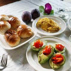 bkf = stuffed avocdo with marinated mini tomato, scrambled egg, rolls and yogurt topped with matcha Chia seed