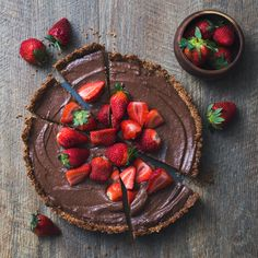 Vegan Chocolate and Strawberry Tart with baked pecan crust and raw banana chocolate custard filling. Gluten Free.