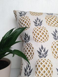 Beautiful Luxury Pineapple 18 x 18 Designer Cushion This stunning cushion has a beautiful pineapple embroidered print design, It makes a great impact - perfect for a peaceful bedroom or to brighten up a lounge. Measuring 18 x 18 the fabric used is a exquisite Spanish embroidered