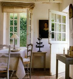 We had a Dutch Door in our kitchen when I was growing up...I loved it!