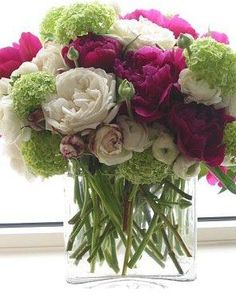 green, raspberry, and ivory blooms