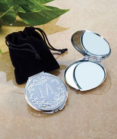 This is nice gift for your bridesmaids....A Monogram Compact Mirror is an elegant, yet practical gift. The cover features a capital letter enhanced by a scrollwork design and the back is also decorated with scrollwork. Open the snap closure to find 1X and 2X mirrors. Comes in a velveteen pouch and a gift box.