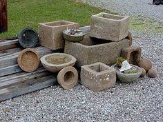 I spent a whole summer playing with  Hypertufa...even made a bench...and it grows MOLD which makes your projects look ancient !...Love it...(this is a borrowed photo)