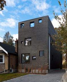 The Charcoal House by Atelier Rzlbd