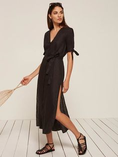 You probably need a vacation. This is a midi length, button front dress with sleeve ties, a detached belt and high slits. http://bit.ly/2pQ94NT