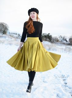 full yellow skirt with black tights and black sweater