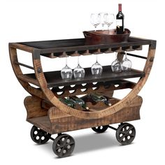 Cocktail Fun. The Farrell bar cart from our Passport line has fun looks and is fully functional. Its medium-toned frame of mango wood brings visual levity to the industrial chic bronze metal wheels and metallic shelves. Geometric extremes unite in this mobile piece among dramatic arches and stringent lines.