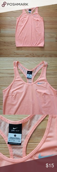 Nike Dri-Fit Light Coral Racerback Tank Top Gorgeous tank top from Nike! Lightweight material makes it cool! The back is a type of mesh material, good for breathability! Has a racerback design! Slightest bit of string came out of bottom as shown in picture. 👌 overall, great condition!  Size S Nike Tops Tank Tops