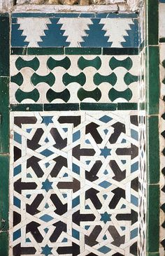 Image SPA 2303 featuring decorated area from the Alcazar, in Seville, Spain, showing Geometric Pattern using ceramic tiles, mosaic or pottery.