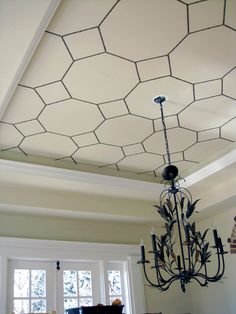 Using a cardboard template, a bunch of these nifty nailhead strips and a lot of patience, create the gorgeous octagonal ceiling pattern for about $65. The geometric patterns set off the ornate chandelier marvelously.