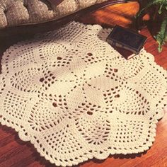 """Pineapples Rug Crochet ePattern - Crochet this pretty pineapples rug as the perfect accent for any room in the house! It works up quickly and easily because it is crocheted using three strands of medium weight yarn and a size N (9.00 mm) hook. This crocheted rug is designed by Anne Halliday; its approximate finished design size is a 42"""" diameter. Original Publication: Leisure Arts Leaflet #2915 - Floor Show."""