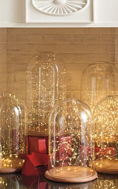 Showcase an antique, a cherished collectible, or a family heirloom in one of our clear, blown Glass Domes with Wooden Base. We love the way a simple strand of micro lights looks...
