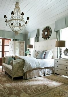Excellent boarded ceiling adds flare. Soft palette brings a calming effect. Heavy lighting and art add drama.