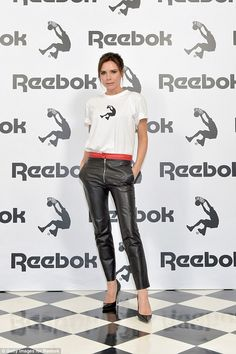 Looking good: Victoria looked super chic in a pair of fitted leather trousers and a sporty T-shirt, teamed with stilettos for a chic twist to the look