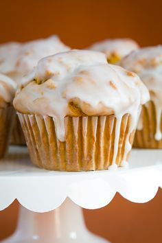 Recipe For Pumpkin Doughnut Muffins with Vanilla Glaze - All that spiced, fluffy, pumpkin-y muffin goodness covered with that perfect, sweet, shell like vanilla glaze.