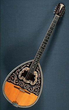 This is a Greek bouzouki. It is the central instrument in all greek music, and it gives greek music its unique sound.