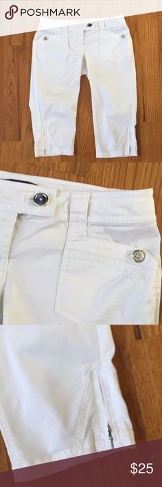 "WHBM white cropped Capri pedal pushers sz 2 Ladies white stretch Crop Leg/pedal pushers pants from WHITE HOUSE BLACK MARKET   Size 8   Waist: 34""   Hips: 42""   Rise: 8.5""   Inseam: 16.5""  with silvertone hardware. Flap hip pockets. Decorative zippers on sides of bottom of legs.  Shell: 98% cotton, 2% spandex.   In excellent gently used condition. No stains, tears or holes.   From a smoke free home. White House Black Market Pants Ankle & Cropped"